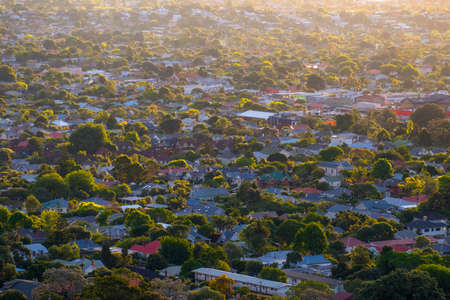 Beautiful View of a town in Auckland, New Zealand. Cloud sunset and town, View from Mt. Eden.