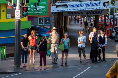2017, DEC 4 - Auckland, NEW ZEALAND, People are waiting of the  crossing pedestrain traffic light in Auckland CBD