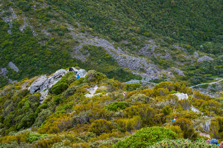 Tourist hiking in hight mountain on Muller hut track in Mt Cook National park