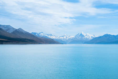 Beautiful scene of Mt Cookbeside the lake with blue sky and clouod in summer. New Zealand