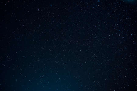 Night scape with beautiful stary sky at the high mountain. Star texture. Space background.  免版税图像