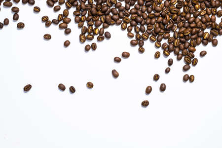 Flay lay style, Medium dark Roasted peaberry coffee beans isolated on white background with copy space for text.