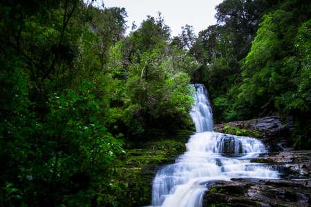 Long Exposure photography. Beautiful waterfall in the rainforest with green nature. Purakaunui Falls, The Catlins, New Zealand. Stock Photo - 102955582