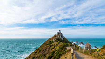 Nugget Point, Rocks cliffs, and beautiful ocean. A path to Lighthouse. The Catlins, New Zealand.