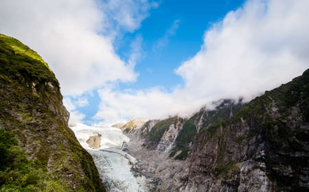 Panorama view, Fraz josef Glacier among the mountain view form Roberts Point Track. West coast, New Zealand. Banco de Imagens