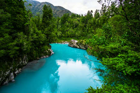 Hokitika Gorge, West Coast, New Zealand. Beautiful nature with blueturquoise color water and wooden swing bridge. Reklamní fotografie