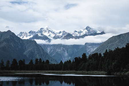 Beautiful landscape of the mountain and the reflection on the lake. Lake Matheson, Fox Glacier, New Zealand. Stockfoto