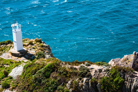 View of the lighthouse at Separation point.The coastline in Abel Tasman National Park, South Island, New Zealand.