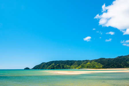A beautiful beach along the coastline in Abel Tasman National Park, South Island, New Zealand. Imagens