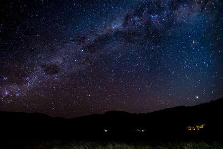 Panorama Starry night Milky way over the mountain. Abel Tasman National Park. Stock Photo