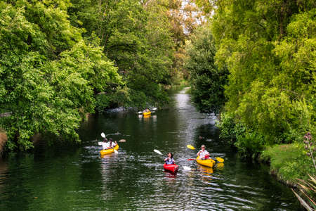 2018 DEC 22, New Zealand, Christchurch, People are kayaking on  the river in Botanic garden.