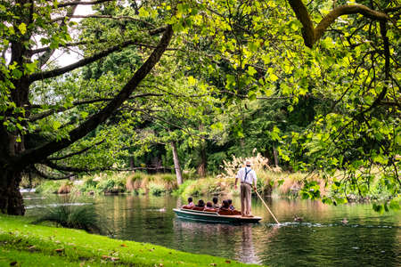 People are enjoing on the boat on the river in Botanic garden..