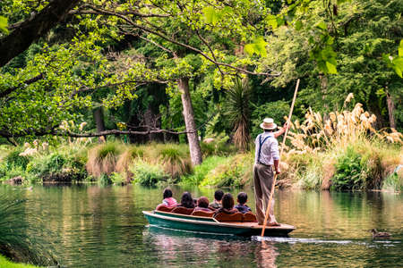 New Zealand, Christchurch, People are enjoing on the boat on the river in Botanic garden..