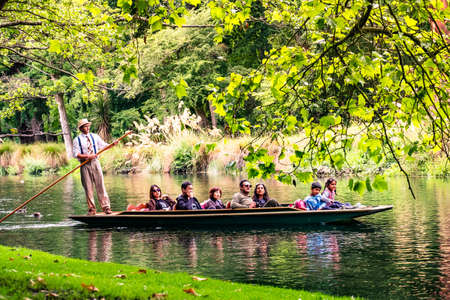2018, DEC 22 - New Zealand, Christchurch, People are enjoing on the boat on the river in Botanic garden..