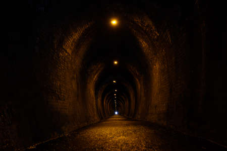 Old brick tunnel. A walkway used to be a railway before. Stock fotó