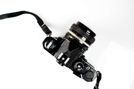 Black old vintage camera isolated on white background..
