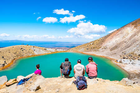 2019 FEB 14, New Zealand, North Island, People enjoying the beautiful Landscape view of Tongariro Crossing track on a beautiful day with blue sky..