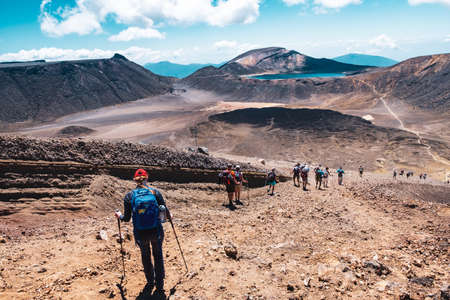 2019 FEB 14, New Zealand, North Island, A group of people trekking in Beautiful Landscape of Tongariro Crossing track on a beautiful day.
