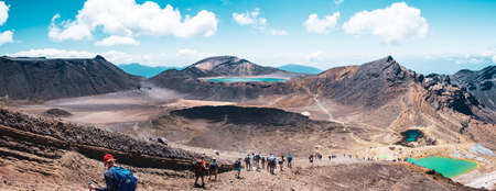 2019 FEB 14, New Zealand, North Island, A group of people trekking in Beautiful Landscape of Tongariro Crossing track on a beautiful day..