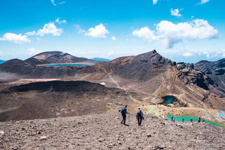 New Zealand, North Island, A group of people trekking in Beautiful Landscape of Tongariro Crossing track on a beautiful day..