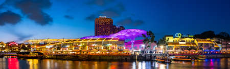 2019 March 1st, Singapore, Clarke Quay - Panorama view City nightscape scenery of colorful the buildings along the river in the city..