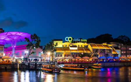 2019 March 1st, Singapore, Clarke Quay - City nightscape scenery of colorful the buildings along the river in the city..