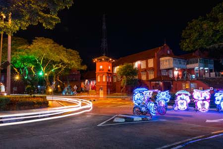 2019 May 8th, Malaysia, Melaka - Long exposure view of the building car and rickshaws beside the road at night..