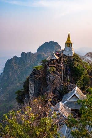 Beautiful view of the temple and stupa on the cliff. Wat Phrachomklao Rachanusorn, Lampang, Thailand.