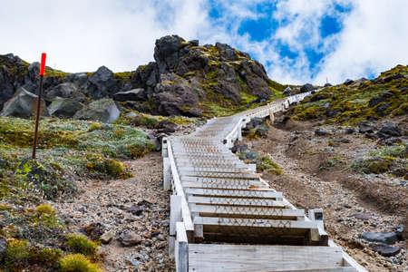 A steep staircase to the top of the mountain. Summit tract, Mount Taranaki, New Zealand. Zdjęcie Seryjne