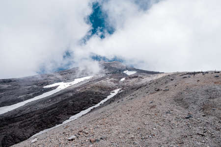 A veiw from high volcano mountain with foggy and ice.