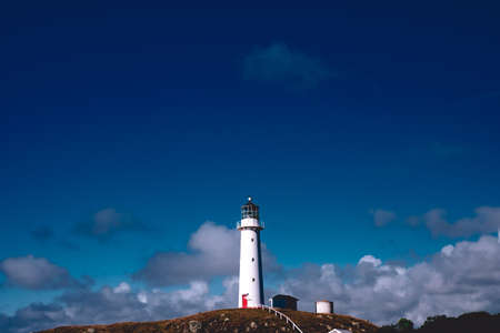 Cape Egmont Lighthouse and starry night. New plymouth, New Zealand. Фото со стока