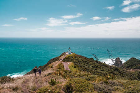 Beautiful landscape scenery of the green mountain blue sky and the lighthouse, the heritage building. Cape Reinga, North Island, New Zealand.