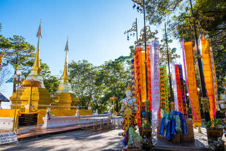 Wat Phra That Doi Tung, Chiang Rai, Thailand. The famous golden pagoda temple decorate with Tung (Northern Thai Flag) (Thai Translate:  Worship words to the Pagodas)
