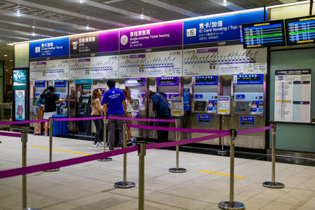 People are buying the MRT ticket from the vending machine at Taoyuan International Airport, Taipei, Taiwan, 30th September 2019.