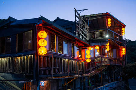 TAIWAN, NEW TAIPEI, Jiufen Village, OCT 2nd, 2019 - A night scene of teahouse buildings decorate with orange Chinese style lantern. Stock Photo