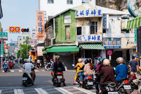 October 16th, 2019 - Taiwan, Tainan, People traffic buildings scene in the city during the day time.
