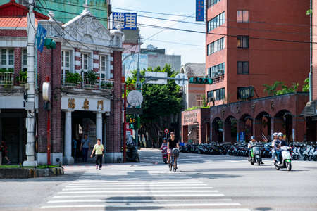 October 6th, 2019 - Taiwan, Taipei, A scene in the city on the roadside, people are cycling and waling crossing road.
