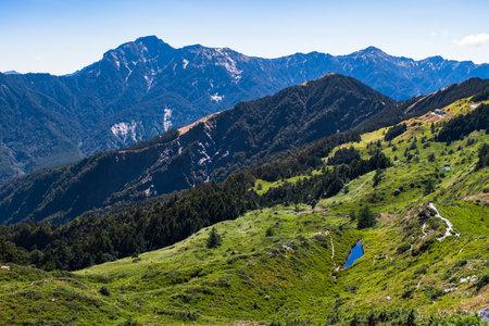 Beautiful Scenery of the green mountain and blue sky at Hehuanshan Main Peak, Taroko National Park, Wuling, Nantou County, Taiwan Фото со стока