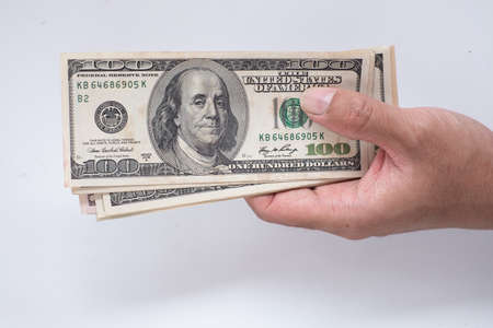 Hand holing American dollars banknotes on white background 免版税图像