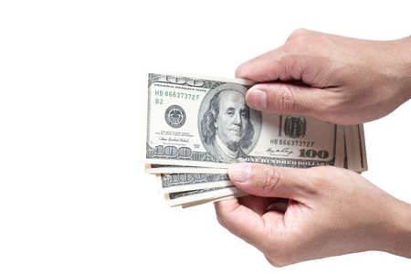 Hand holing American dollars banknotes on white background Фото со стока