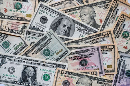 Many of American dollars banknotes background.
