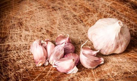 garlics: Garlics on wooden table
