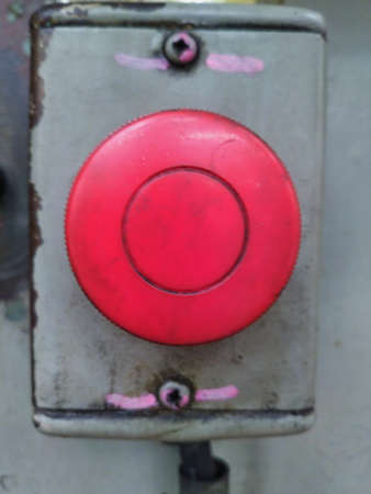The emergency button has been installed on the machine for many years until it looks old.