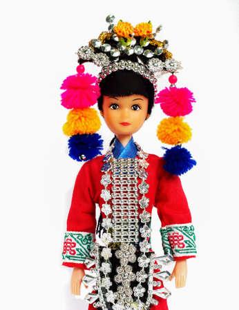 asian family: Tribal dolls isolated white backdrop.