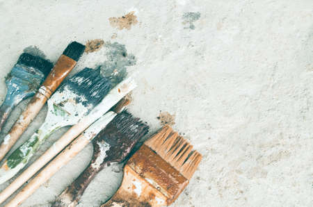 smears: Painters brush smears of paint put on a dirty color. Stock Photo