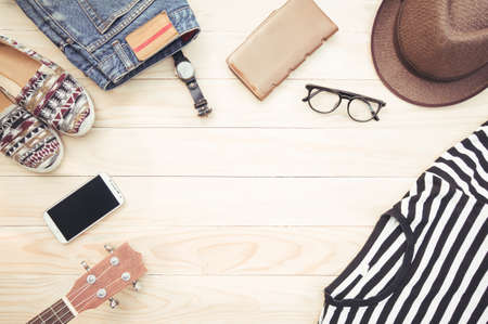 antecedents: Casual apparel and accessories on a background of wood. Stock Photo