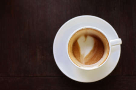 Drinking a cup of coffee Four heart shaped latte art Donegal blur.
