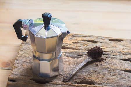 percolator: Moka pot and coffee on the wooden spoon.