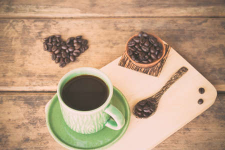 tomando refresco: Cup of coffee and coffee beans on a wooden spoon spelling I love coffee.