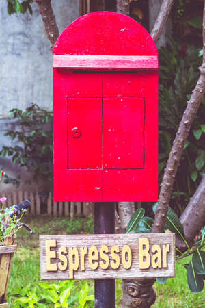postbox: Old postbox red background.